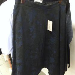 Yune Ho navy asymmetric skirt, $230 (was $385)