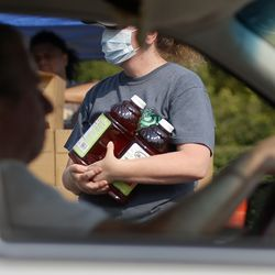 Jerry Dolejs drives through the Food Bank mobile pantry at The Church of Jesus Christ of Latter-day Saints Cannon Stake Center in Salt Lake City on Wednesday, Sept. 1, 2021. Dolejs keeps a few items for himself and gives the majority of the food to his neighbor who has a large family.