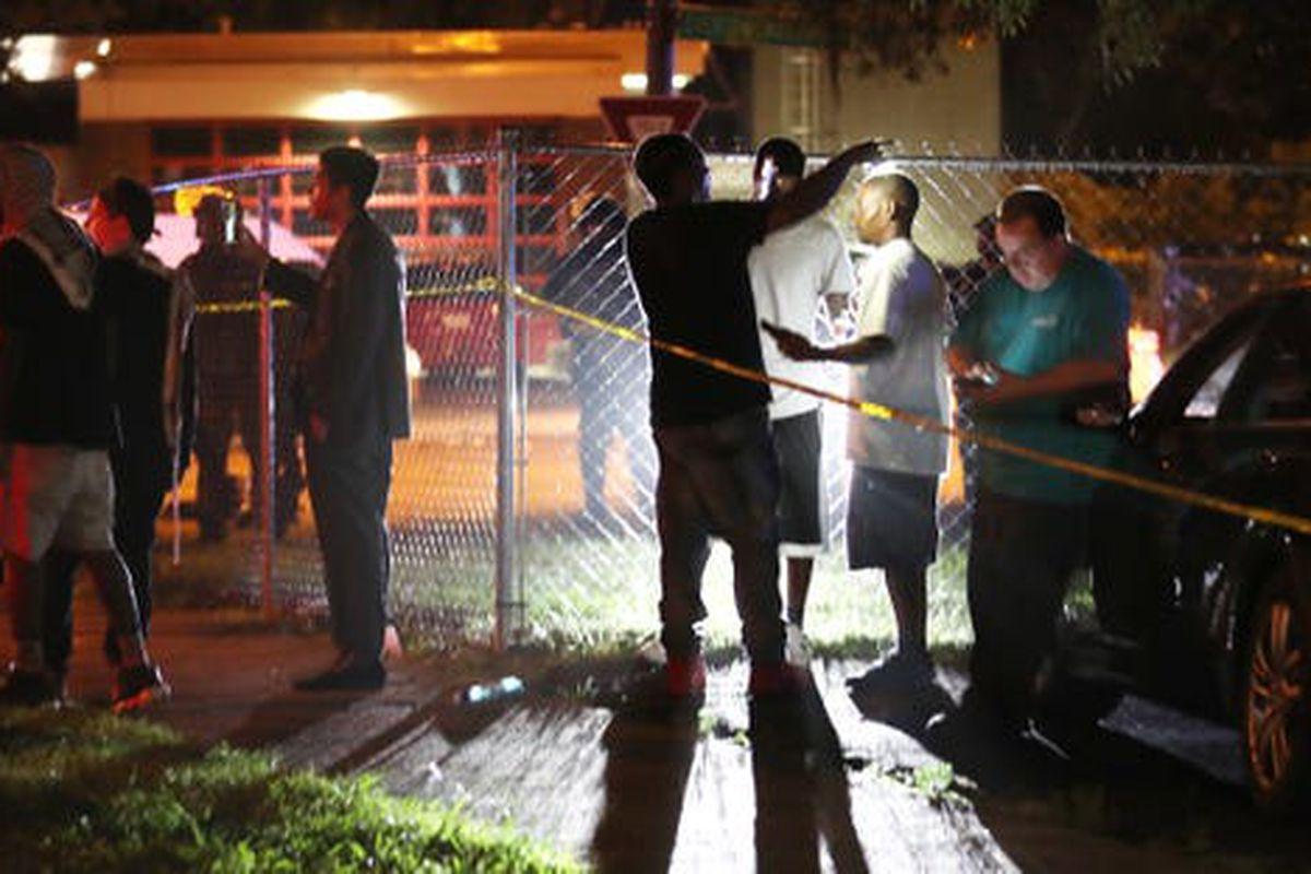 Onlookers talk following an shooting in Frayser involving the U.S. Marshals Service that left Brandon Webber dead on June 12, 2019.