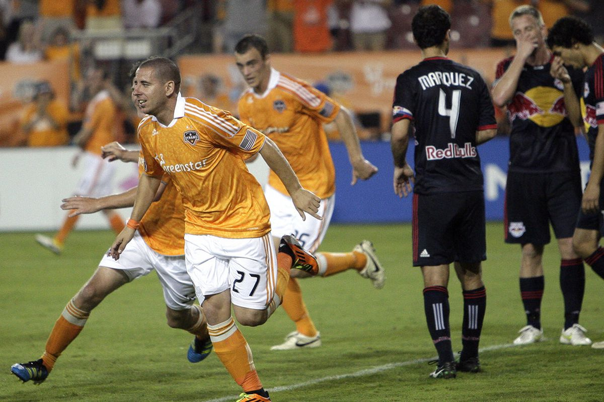 HOUSTON - MAY 21: Koke #27 of the Houston Dynamo scores in the second half against the New York Red Bulls at Robertson Stadium on May 21, 2011 in Houston, Texas. (Photo by Bob Levey/Getty Images)