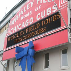 """There is a gap in the fence, so this """"tourist"""" shot of the marquee is possible. (Note: I did not time this. It seems that whenever I want to take photos of the marquee, the tour message is on display.)"""