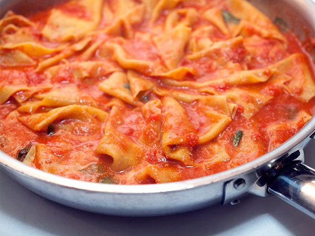 A pan of red sauce pasta.