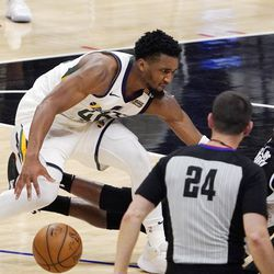 Utah Jazz guard Donovan Mitchell, left, knocks down Los Angeles Clippers guard Reggie Jackson before injuring himself during the second half in Game 6 of a second-round NBA basketball playoff series Friday, June 18, 2021, in Los Angeles.