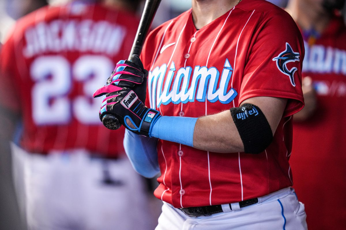 A detailed view of the Franklin batting gloves worn by Miguel Rojas #19 of the Miami Marlins in the dugout during the game against the Chicago Cubs at loanDepot park