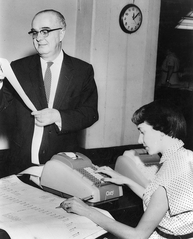 """Photograph caption dated November 3, 1958 reads: """"Registrar of Voters Benjamin S. Hite prepares office for expected record turnout of 75 per cent of Los Angeles County's 2,793,997 registered voters Tuesday. Registrar's office will employ 700 additional persons for speed vote tabulations Tuesday night."""""""