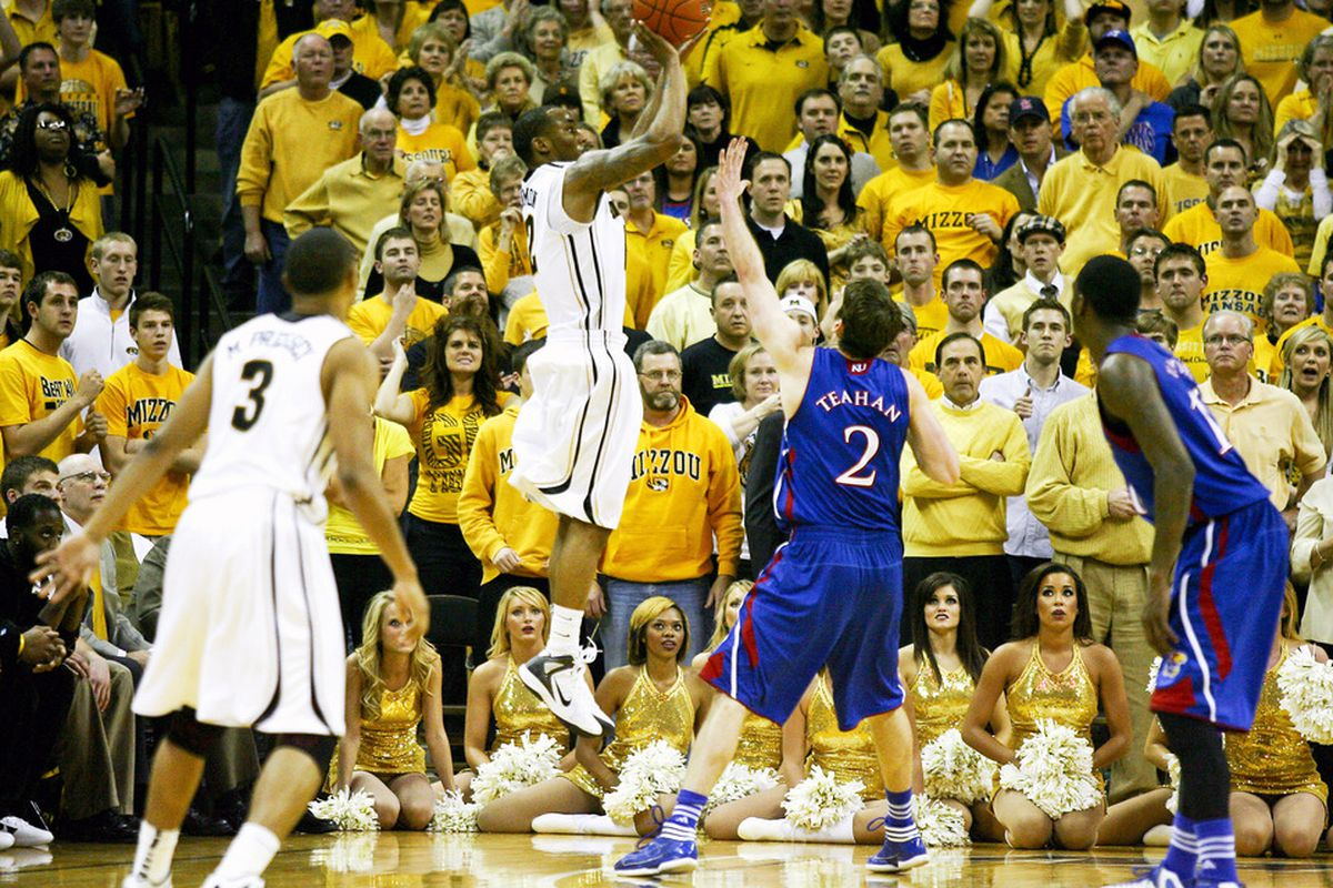 COLUMBIA, MO - FEBRUARY 04: Marcus Denmon #12 of the Missouri Tigers takes a shot over Conner Teahan #2 of the Kansas Jayhawks. The shot completed a 8-point comeback in the last three minutes of the game. (Photo by Ed Zurga/Getty Images)