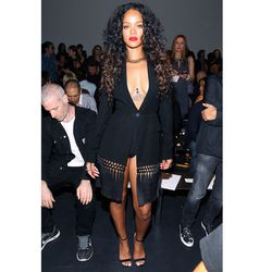 Later that day, Rihanna wore a couture robe with hefty tassels to <strong>Altuzarra</strong>'s show. The plunging neckline worked well with her peek-a-boo body chain.