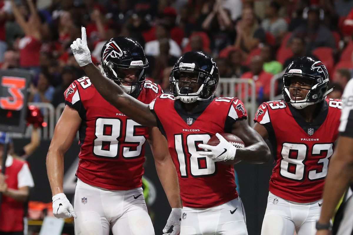 Atlanta Falcons wide receiver Calvin Ridley (18) celebrates his touchdown catch with tight end Eric Saubert (85, left) and wide receiver Russell Gage (83) in the second quarter against the Kansas City Chiefs at Mercedes-Benz Stadium. Mandatory Credit: Jason Getz