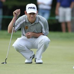 Louis Oosthuizen, from South Africa, reads the green on the seventh hole during the second round of the Deutsche Bank Championship PGA golf tournament at TPC Boston in Norton, Mass., Saturday, Sept. 1, 2012.