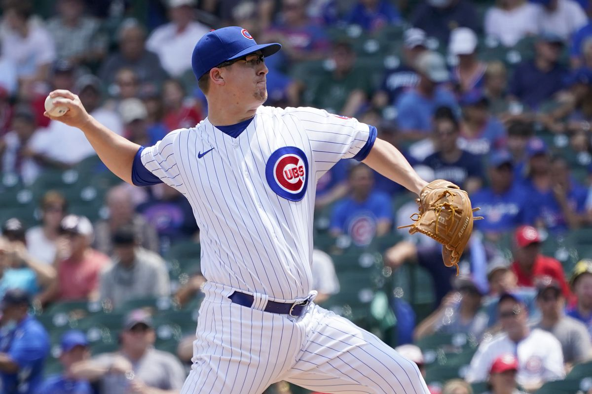 Cubs starting pitcher Alec Mills delivers during the first inning against the Reds on Thursday.