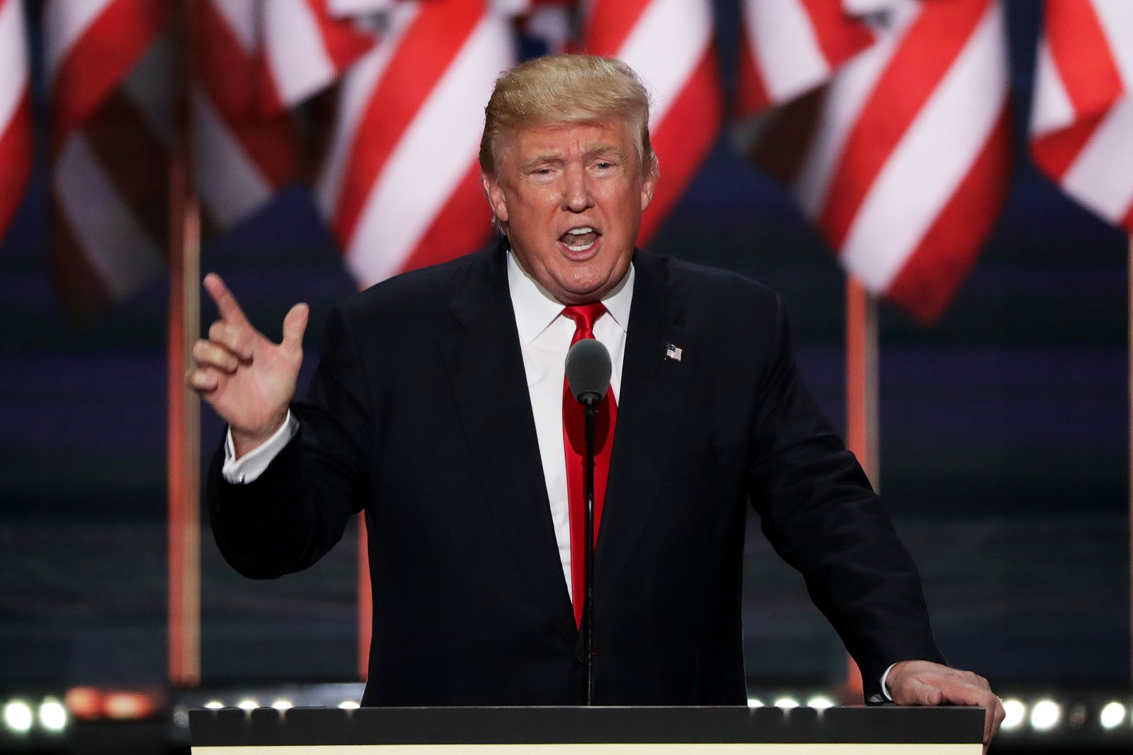 Donald Trump gesturing with his right hand, pointing up and to the right with a bent elbow, during a speech to the Republican National Convention in Cleveland in 2016.