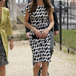 At the June 11th, 2011 wedding of Sam Waley-Cohen and Annabel Ballin in a satin Zara dress and a James Lock & Company hat. She is carrying Anya Hindmarch's 'Maud' clutch.