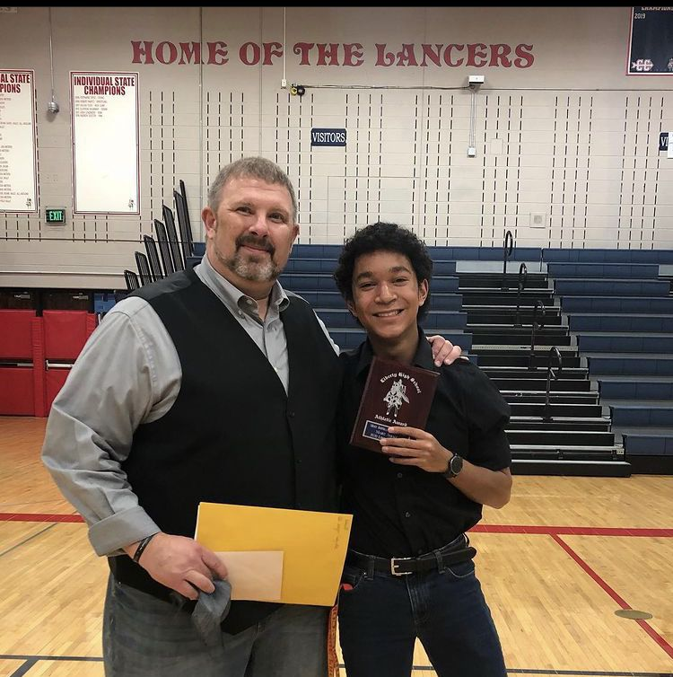 Marc Small with his football coach after winning Most Inspirational Player.