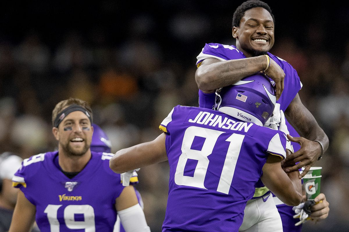 Minnesota Vikings Stefon Diggs greeted Olabisi Johnson after he caught an 18-yard pass for a touchdown in the second quarter.