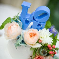 """From Etsy, this <a href=""""http://www.etsy.com/listing/116251077/wedding-cake-topper-perfect-for?ref=v1_other_2"""">LOVE Cake Topper</a> ($110) is a nod to Philly without being too """"theme-y."""""""
