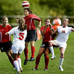 Bountiful's Felicia Sturgeon soars above the crowd for a header against Park City on Tuesday afternoon. Sturgeon scored the Braves' fourth goal in their blowout victory.