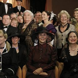 Passengers in costumes pose for a group picture following a reception at the MS Balmoral Titanic memorial cruise ship, in the Atlantic Ocean, Friday, April 13, 2012. Nearly 100 years after the Titanic went down, the cruise with the same number of passengers aboard is setting sail to retrace the ship's voyage, including a visit to the location where it sank. The Titanic Memorial Cruise departed Sunday, April 8, from Southampton, England, where the Titanic left on its maiden voyage and the 12-night cruise will commemorate the 100th anniversary of the sinking of the White Star liner early Sunday, April 15, 2012. (AP Photo/Lefteris Pitarakis)