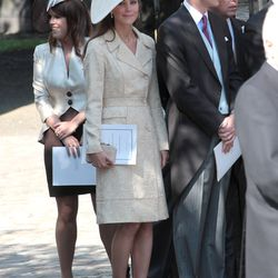In a Jane Troughton embroidered coat, with L.K. Bennett heels and clutch for the July 30th, 2011 wedding of Zara Phillips and Mike Tindall Canongate.