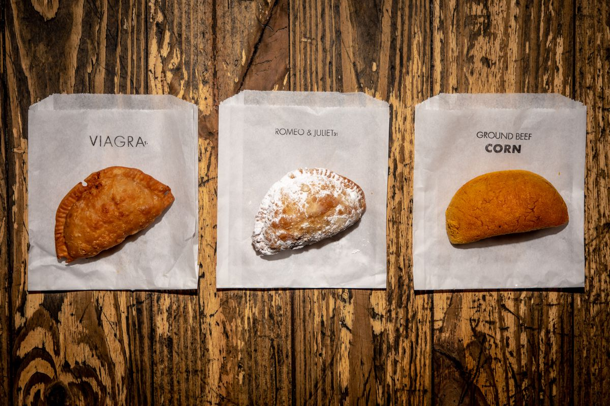 The Viagra, Romeo & Juliet, and ground beef empanadas sit on wax paper over a wooden table