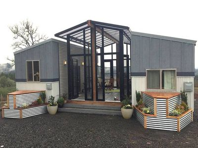 Two tiny houses and open-air sunroom combine into one family home
