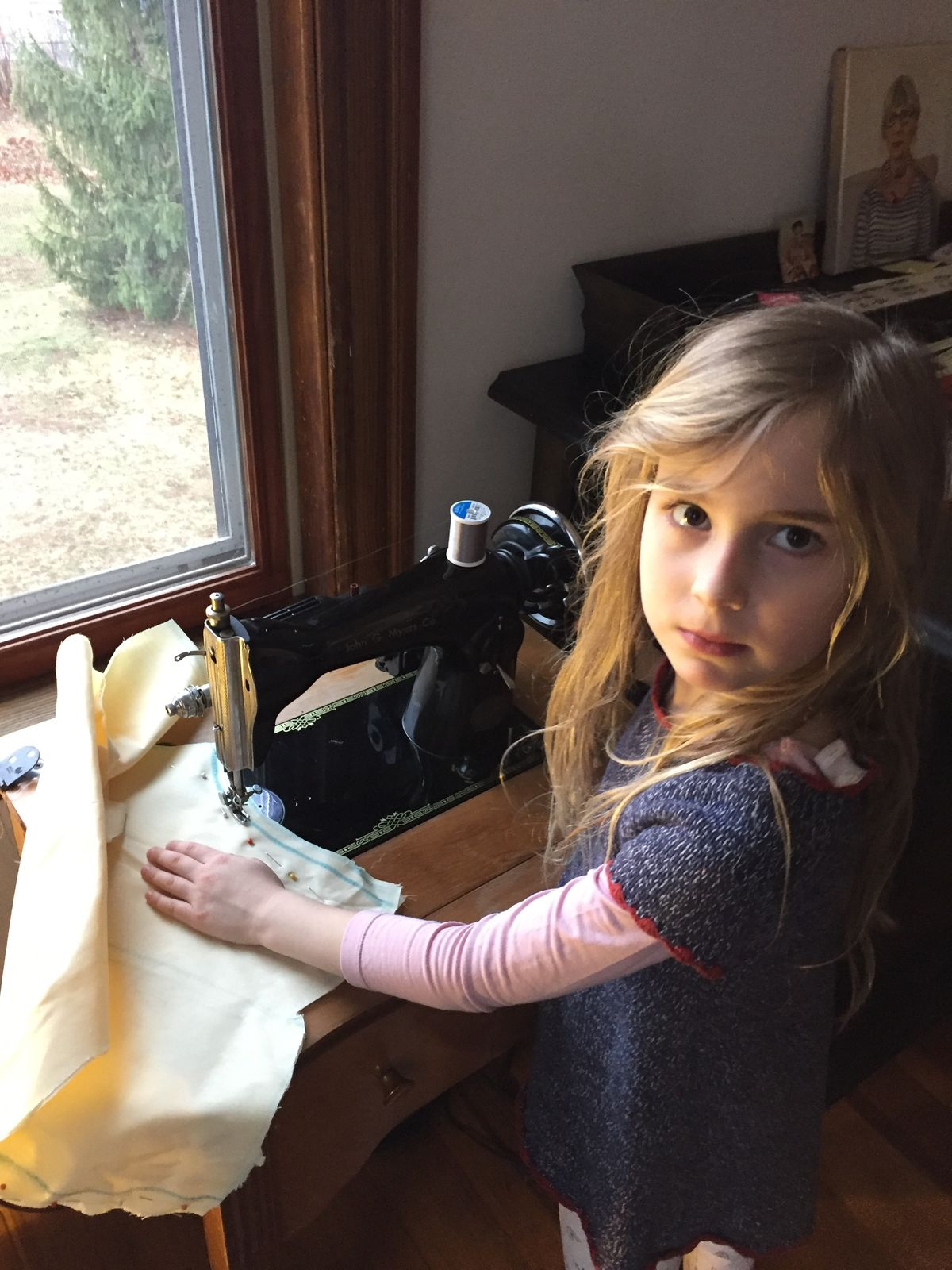 Early in the pandemic, Star Atkeson's daughter, Isabel, worked on a sewing project.