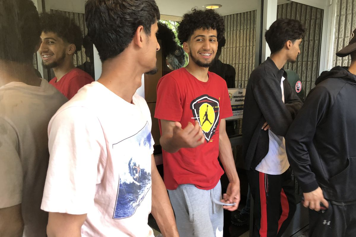 Students hoping to obtain their transcripts waited outside their Detroit charter school, Universal Academy, for more than an hour in early July. Office workers inside would not unlock the door.