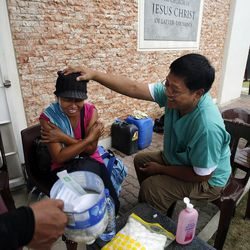 Dr. Alex Castillo teases Analyn Esperas after giving her a tetanus shot at the San Juanico chapel of The Church of Jesus Christ of Latter-day Saints in Tacloban, Friday, Nov. 22, 2013.