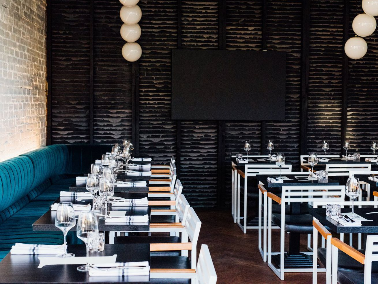 empty restaurant with blue seating
