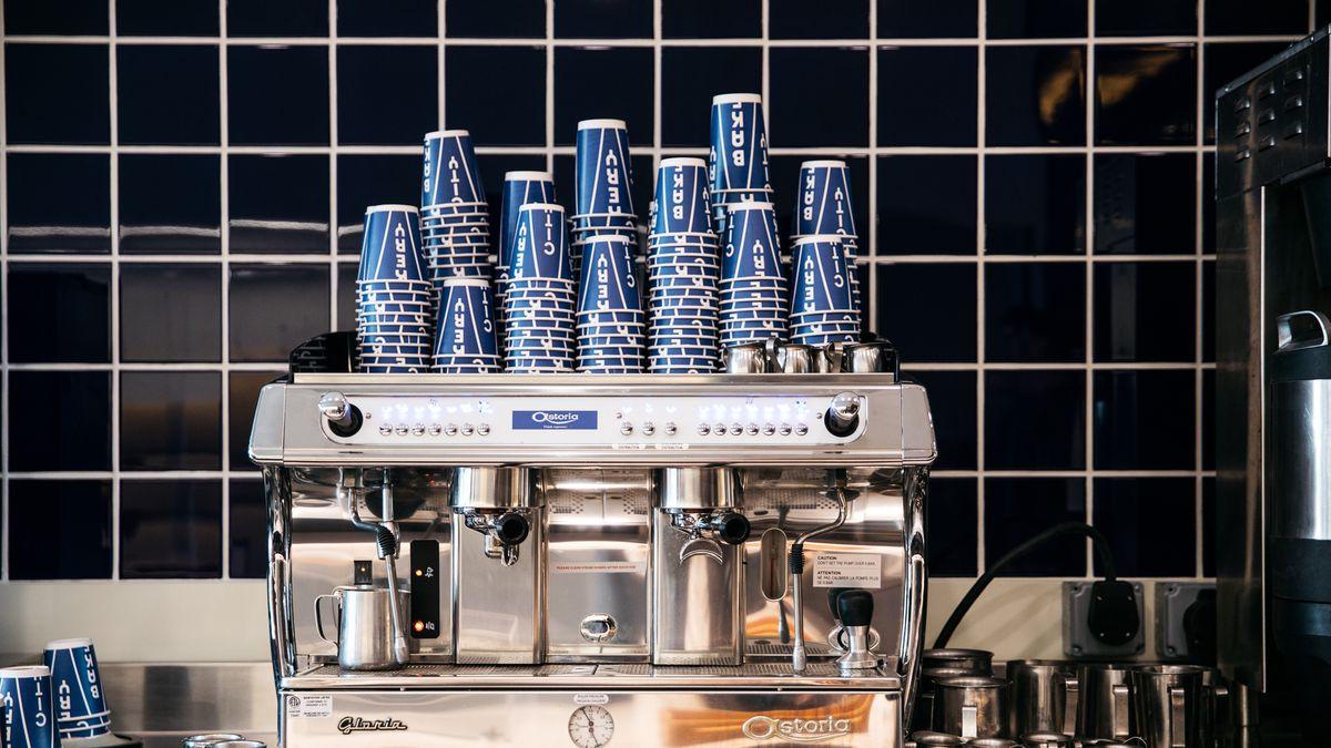 city bakery cups on espresso machine