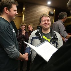 Ryan Child and Zach Tomney are all smiles as they get married by the Rev. Curtis Price of the First Baptist Church at the County Clerks Office in Salt Lake City on Friday, Dec. 20, 2013. A federal judge Friday struck down Utah's Amendment 3  which defines marriage as the union of one man and one woman  finding that it violates rights to due process and equal protection as set forth in the 14th Amendment.