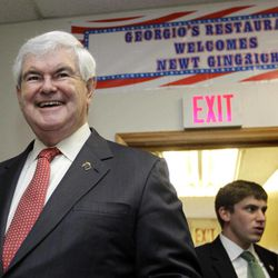 Republican presidential candidate, former House Speaker Newt Gingrich smiles as he greets supporters at a campaign event in Cramerton, N.C., Wednesday, April 25, 2012.