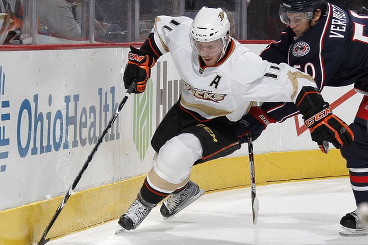 COLUMBUS OH - OCTOBER 20: Saku Koivu #11 of the Anaheim Ducks controls the puck in front of Antoine Vermete #50 of the Columbus Blue Jackets on October 20 2010 at Nationwide Arena in Columbus Ohio.  (Photo by Gregory Shamus/Getty Images)