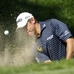 Lee Westwood, of England, hits out of the bunker on the ninth green during the final round of the BMW Championship PGA golf tournament at Crooked Stick Golf Club in Carmel, Ind., Sunday, Sept. 9, 2012.