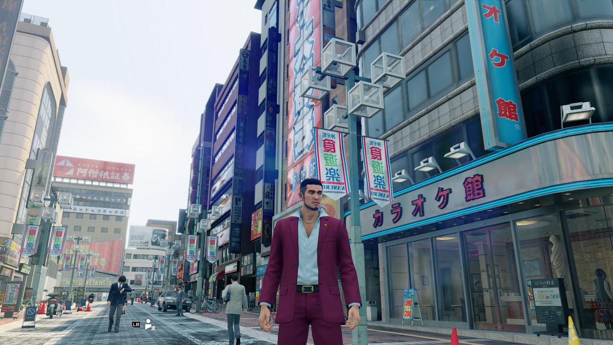 Ichiban walks down a busy city street in Yakuza: Like a Dragon