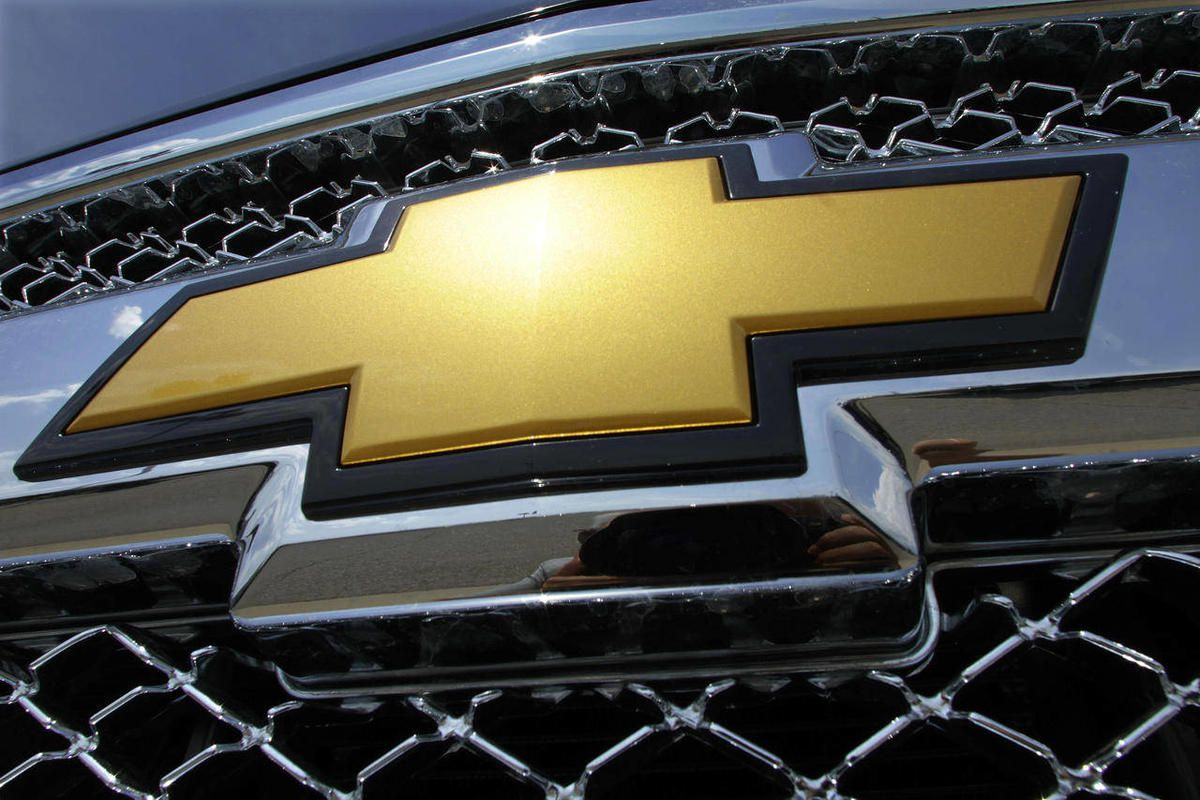 """In this July 8, 2012 file photo, the Chevrolet logo shines on a Silverado pickup truck at an auto dealership in Springfield, Ill. Ever since the company left bankruptcy three years ago, General Motors' ads haven't boosted sales much. The company""""™s bigges"""