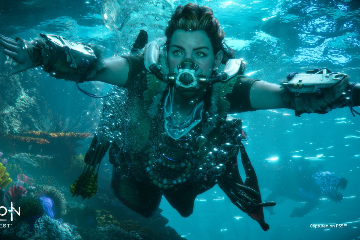 Aloy swimming past a coral reef in Horizon Forbidden West
