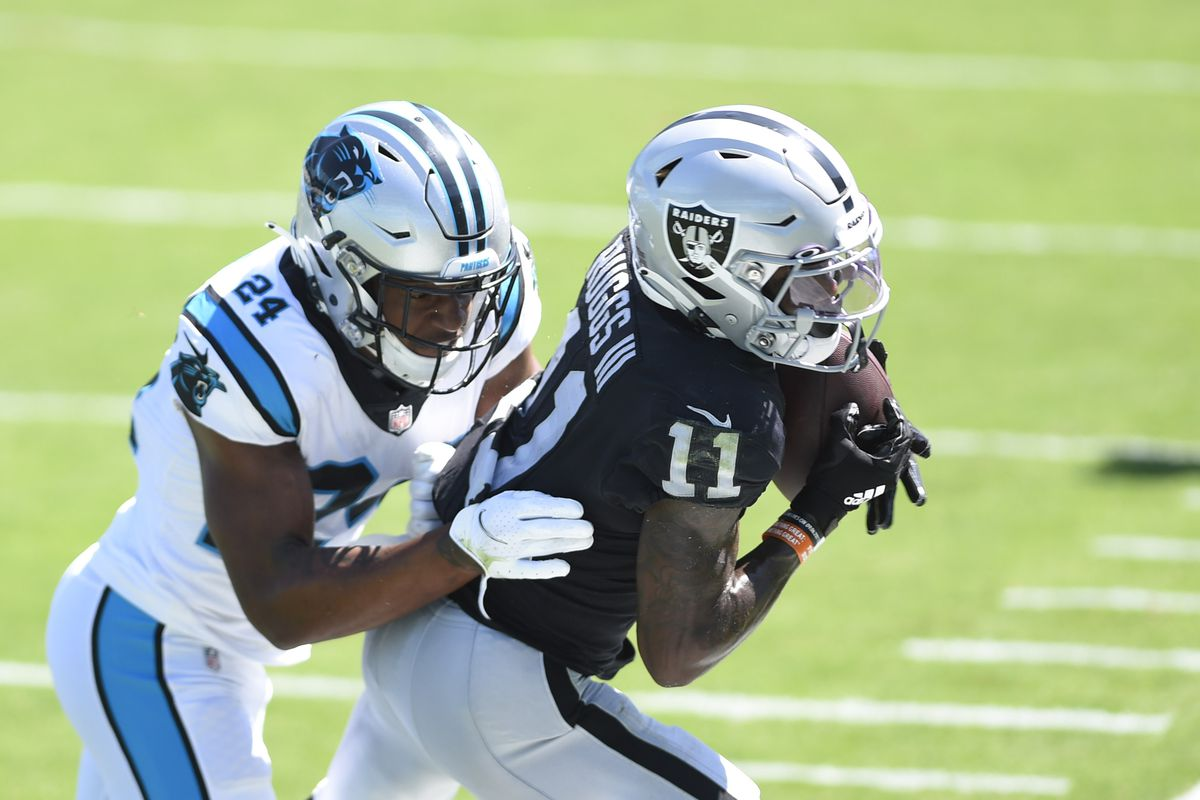Las Vegas Raiders wide receiver Henry Ruggs III (11) tries to make a catch as Carolina Panthers cornerback Rasul Douglas (24) defends in the second quarter at Bank of America Stadium.