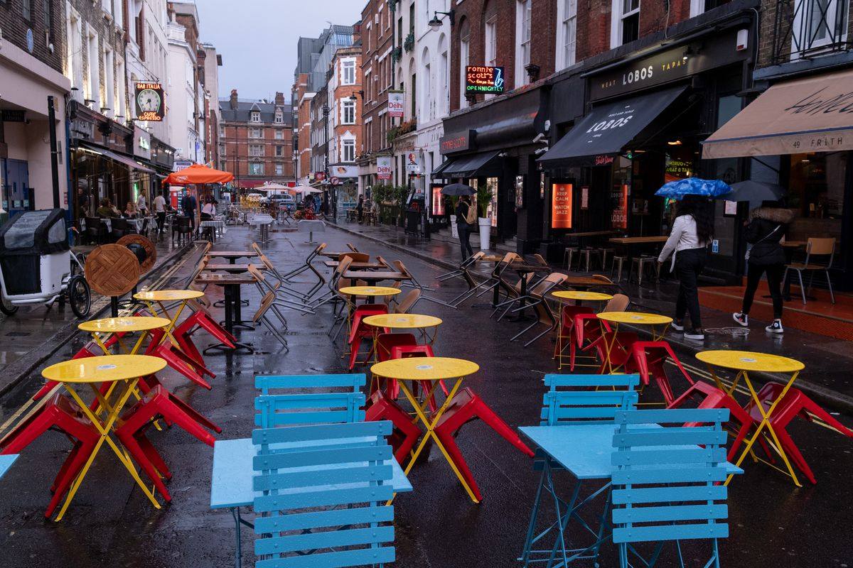 Empty Soho restaurant tables in central London