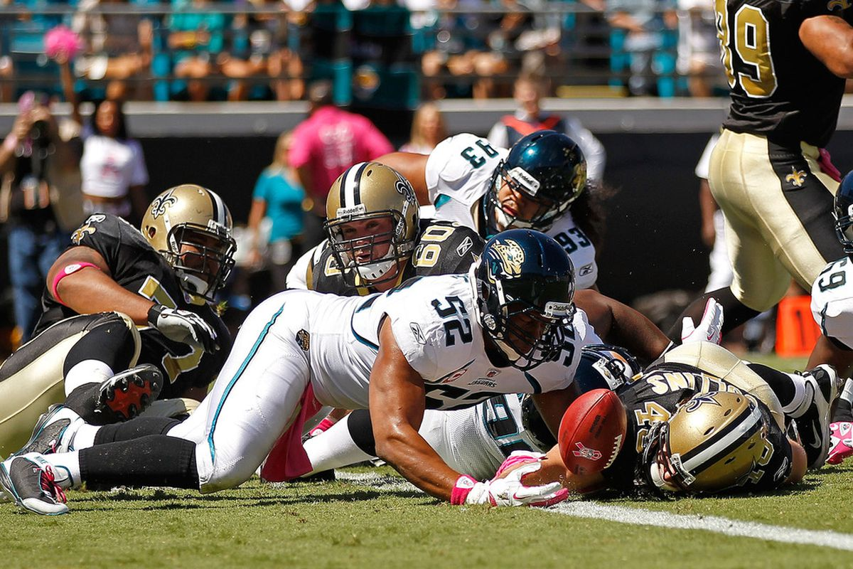 JACKSONVILLE, FL - OCTOBER 02:  Jed Collins #45 of the New Orleans Saints scores a touchdown during a game against the Jacksonville Jaguars at EverBank Field on October 2, 2011 in Jacksonville, Florida.  (Photo by Mike Ehrmann/Getty Images)