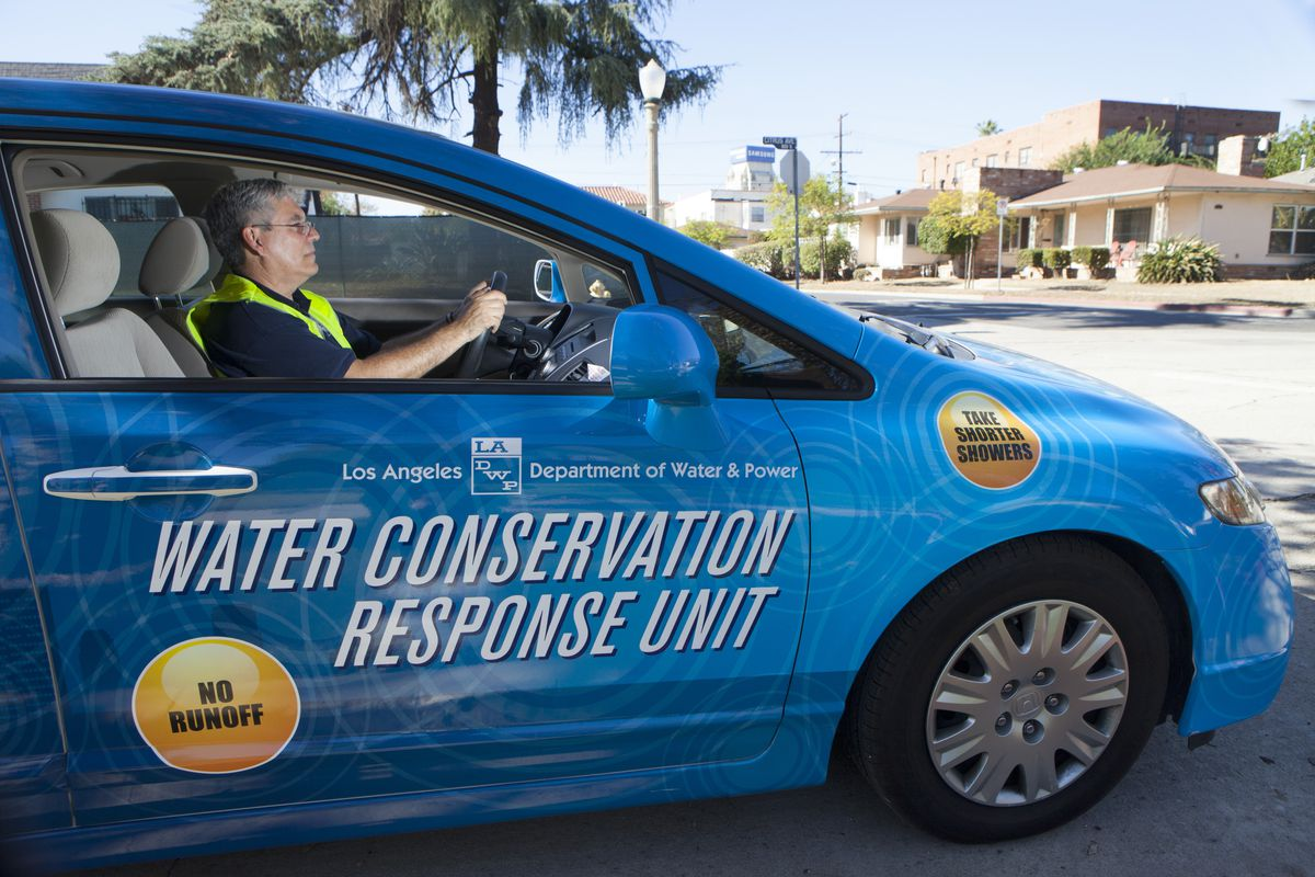 A member of the LA Department of Water and Power's Water Conservation Response Unit searches for people violating water usage rules, on November 5, 2014 in Los Angeles, California. (Melane Stetson Freeman/Christian Science Monitor/Getty Images)