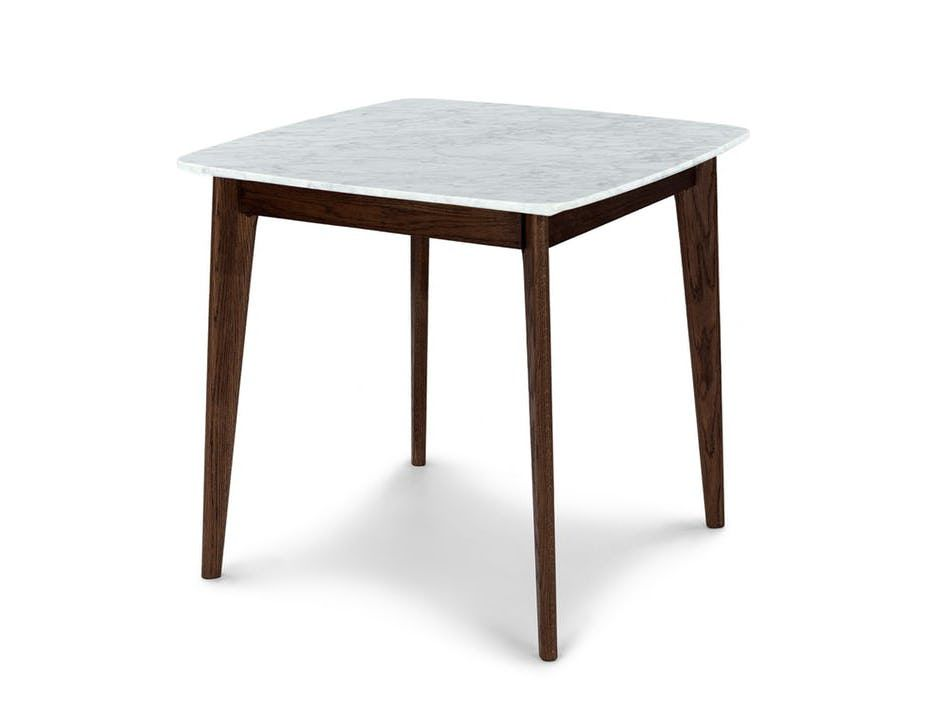A square table with a white marble top and tapered dark wood legs.