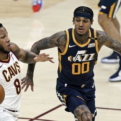Cleveland Cavaliers' Lamar Stevens (8) drives to the basket against Utah Jazz's Jordan Clarkson (00) in the second half of an NBA basketball game, Tuesday, Jan. 12, 2021, in Cleveland.
