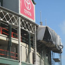 11:52 a.m. A close view of the scaffolding, along the top of the Addison Street side of the front of the ballpark -