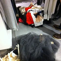 Piles of dresses in the fitting rooms