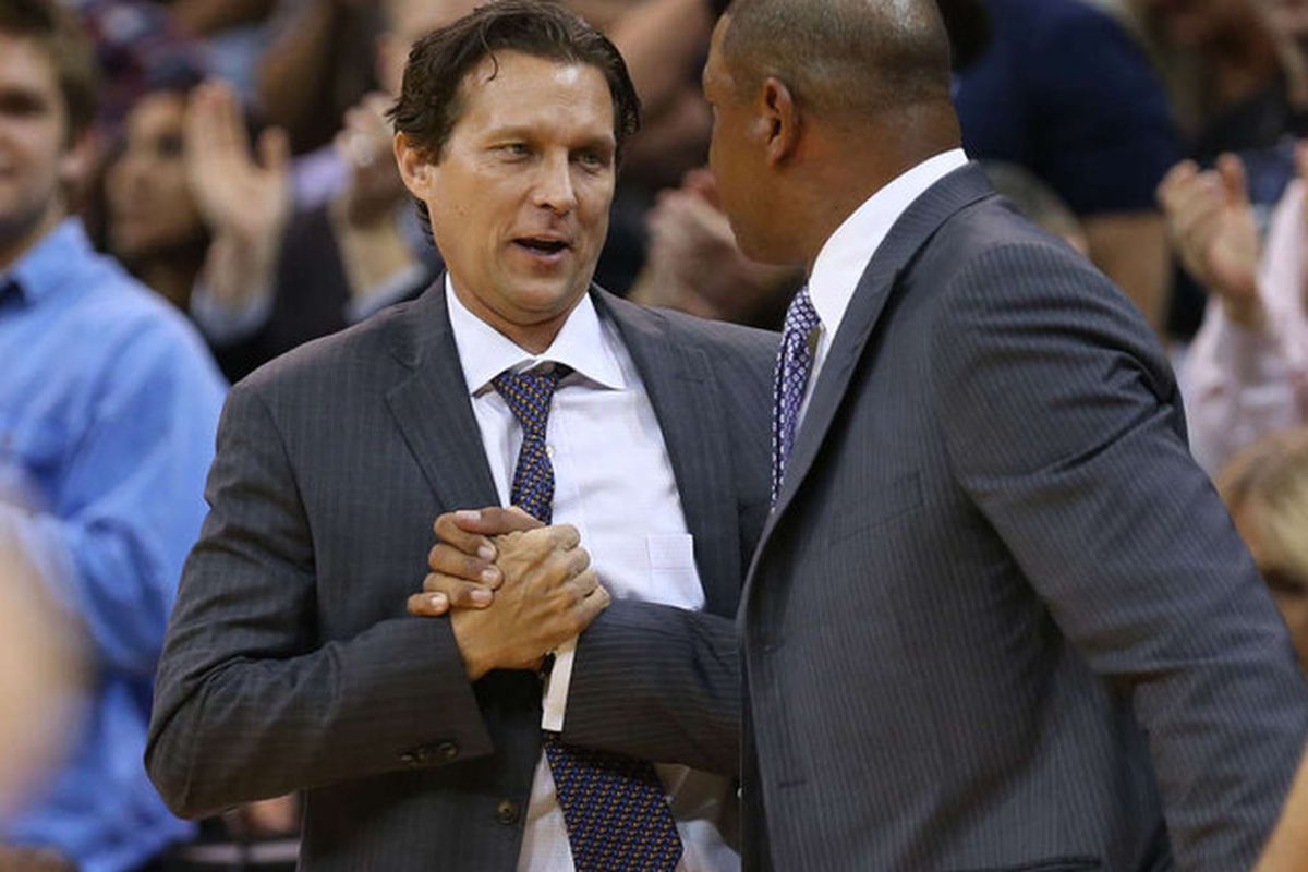Utah Jazz head coach Quin Snyder, left, and Los Angeles Clippers head coach Doc Rivers shake after the Utah Jazz defeat the LA Clippers 102-89 as they play pre-season NBA basketball Monday, Oct. 13, 2014, in Salt Lake City.