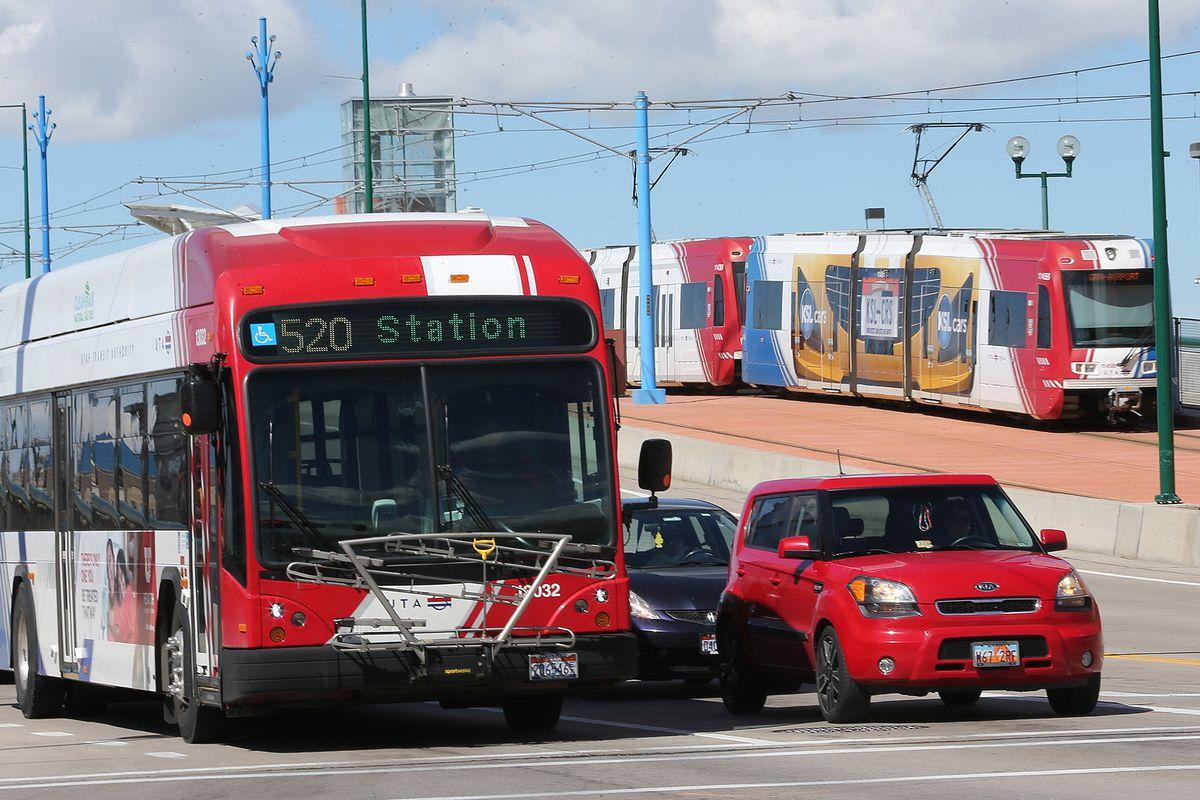 A UTA bus and TRAX train move through Salt Lake City on Tuesday, April 4, 2017.