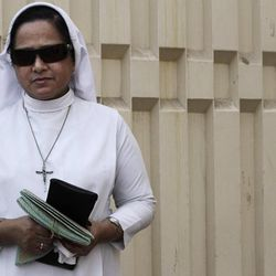 In this Thursday, Aug. 30, 2012 photo, a Bahraini nun stands near the gate of Sacred Heart Church in Manama, Bahrain. When Bahrain announced plans to build the largest Roman Catholic Church in the Gulf, it was accompanied by a noticeable dose of pride to showcase its traditions of religious tolerance. Instead, the planned church has turned into another point of tension in a country already being pulled apart by internal sectarian battles.