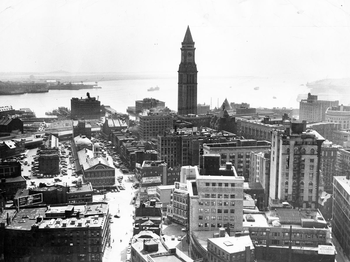 View of an old city skyline with one lone, thin tower towering over everything.