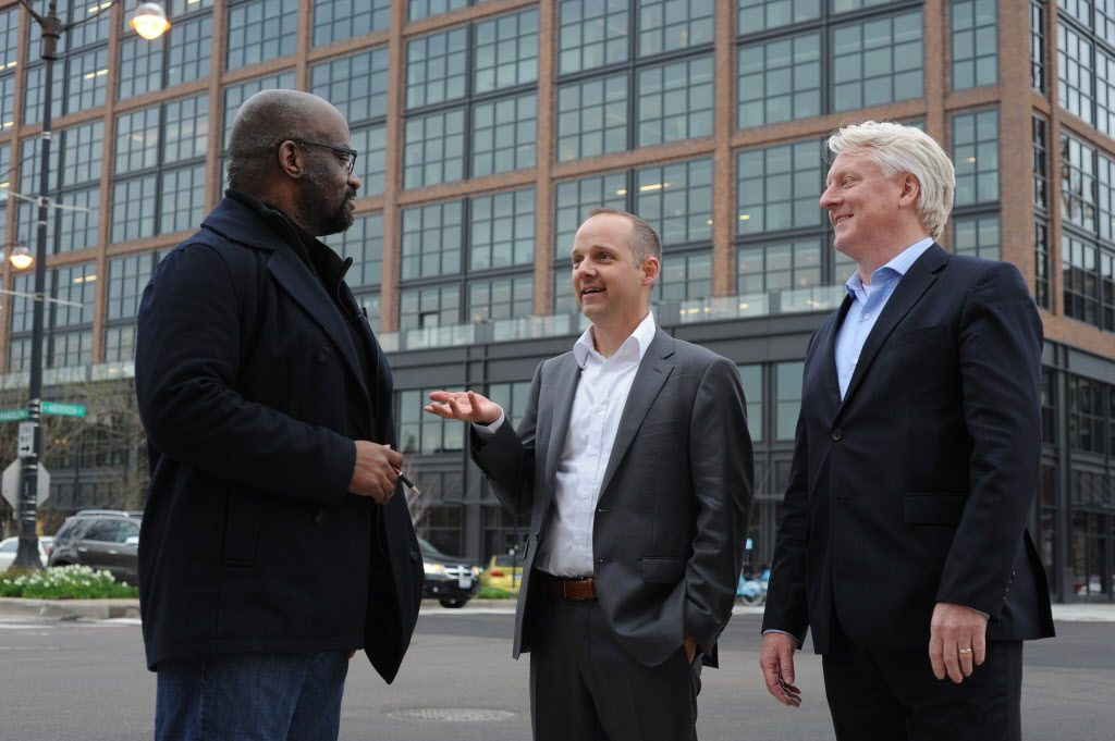 Architect Jacob Mertens (center) and Grant Uhlir (right) from Gensler architecture firm talks with architecture critic Lee Bey about exterior and design features of the new McDonald's headquarters building in Chicago's Fulton Market district.   Victor Hil