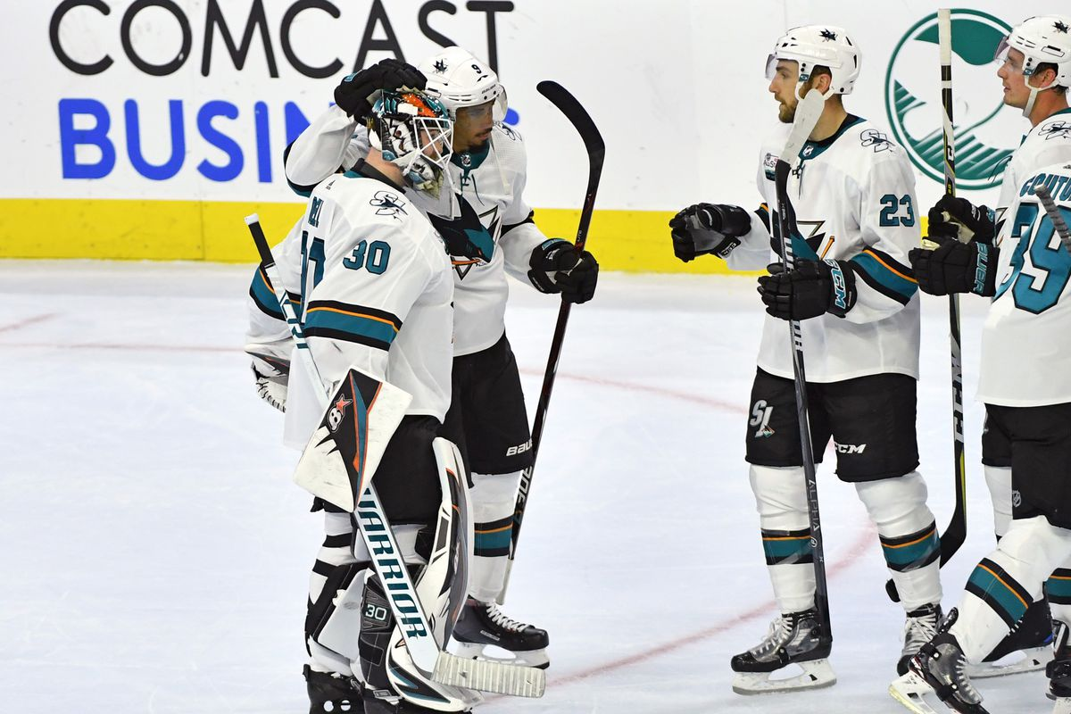 Oct 9, 2018; Philadelphia, PA, USA; San Jose Sharks goaltender Aaron Dell (30) and left wing Evander Kane (9) celebrate win with right wing Barclay Goodrow (23) against the Philadelphia Flyers at Wells Fargo Center.